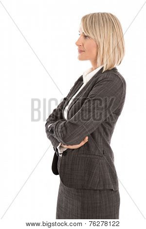 Attractive isolated mature female manager wearing costume and blouse looking sideways to text.