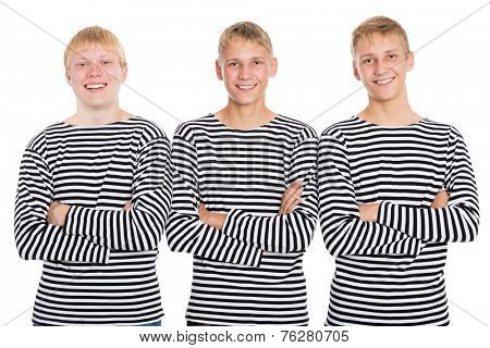 Smiling guys in a striped shirt with arms crossed. Two of the boys twin brothers.