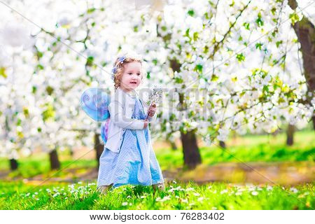 Little Girl In Apple Garden