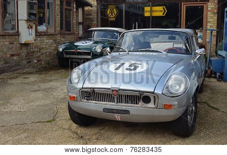 Classic MG Sports Cars on garage forecourt.