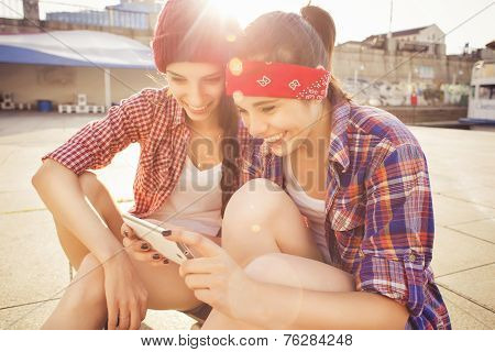 Two Brunette teenage girls friends in hipster outfit