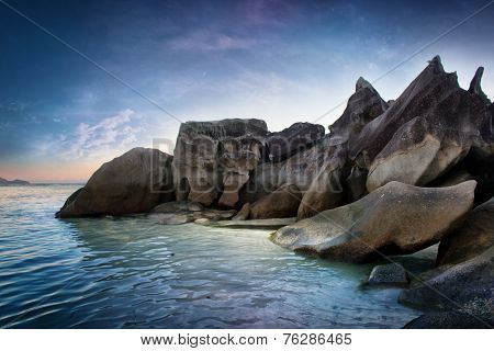 Close up Large Granite Rocks on Blue Green Sea Water at Famous Mahe Island, Seychelles