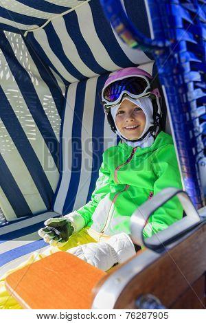 Ski, winter fun - lovely skier girl enjoying ski vacation