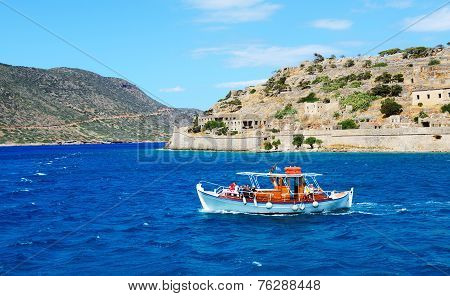 Spinalonga, Greece - May 14: The Motor Yacht With Tourists Is Near Spinalonga Island On May 14, 2014