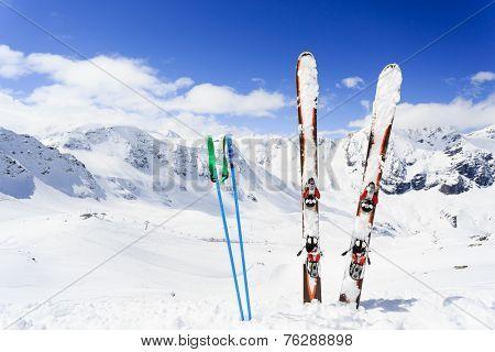 Skiing , mountains and ski equipments on ski run