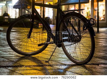 Bicycle With Evening City Lights
