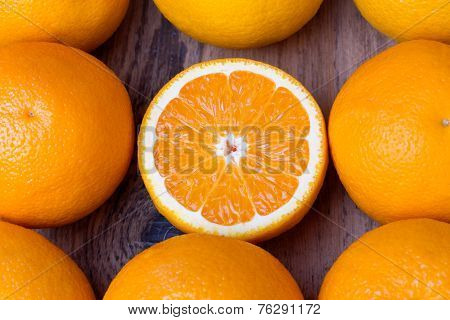 many fresh oranges on wooden background