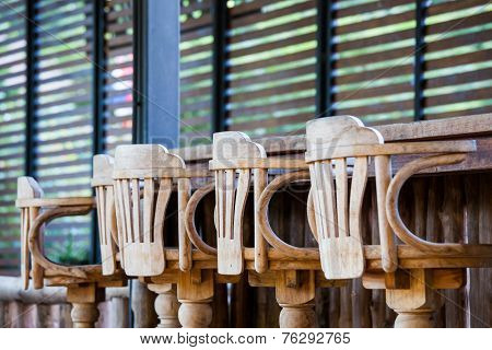 Old wooden chair in front of bar