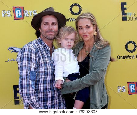 LOS ANGELES - NOV 16:  Greg Lauren, Sky Cole Lauren, Elizabeth Berkley at the PS Arts Express Yourself Benefit at the Barker Hanger on November 16, 2014 in Santa Monica, CA