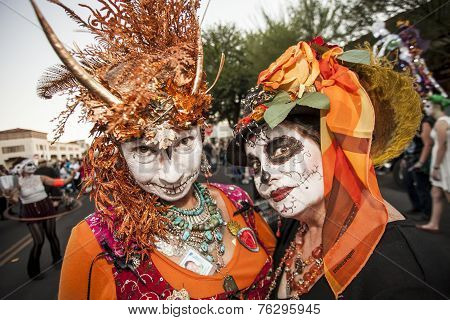 Women In Dramatic Dia De Los Muertos Makeup