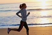 picture of morning  - woman running on beach in morning sunrise fitness workout sport - JPG