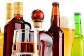 stock photo of ethanol  - Bottles and glasses of assorted alcoholic beverages over white background - JPG