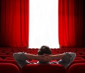 stock photo of ceremonial clothing  - cinema screen red curtains opening for one vip person - JPG