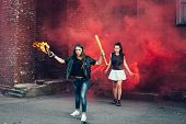 picture of teen smoking  - Two young fans with Molotov cocktail and red smoke bombin the street - JPG