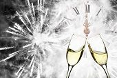 picture of congrats  - Glasses with champagne against holiday lights and fireworks - JPG