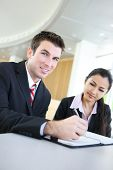 picture of asian woman  - A diverse attractive man and woman business team in meeting - JPG
