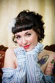 pic of rockabilly  - Portrait of rockabilly girl in a striped shirt in a Victorian setting - JPG