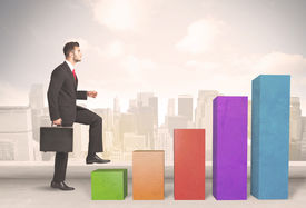 stock photo of climb up  - Business person climbing up on colourful chart pillars concept on city background - JPG