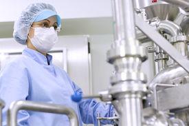 image of pharmaceuticals  - Preparing machine for work in pharmaceutical factory - JPG