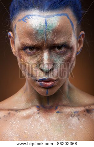 Young woman with fantasy make up. Cose up face art studio shot.