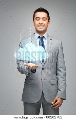business, people, technology and computing concept - happy businessman in suit showing or holding virtual cloud projection on palm over gray background