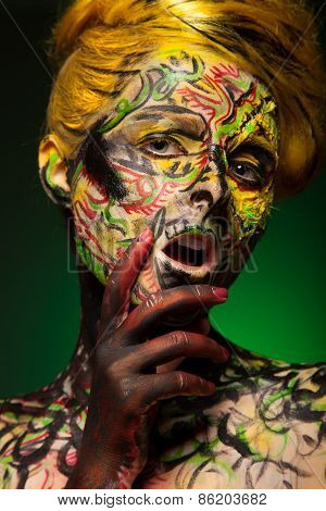 woman with face-art and body art paint. Yellow hair