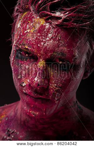 Creepy portrait of a halloween man with bloody body art and face art.