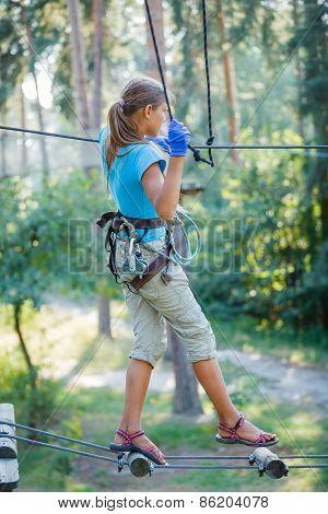 Girl in a climbing adventure park