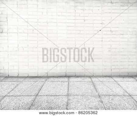 Wall made of bricks and floor from stone. Place for text