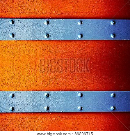 a metal background with a strip of rivets