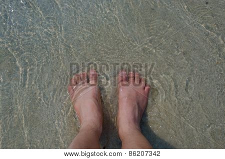 Feet Over The Beach