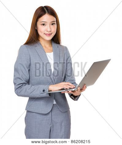 Young asian businesswoman using laptop