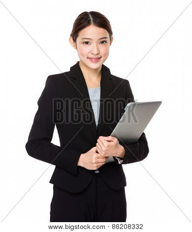 Attractive smiling young woman holding laptop computer