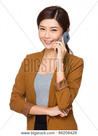 Asian businesswoman talking by cellphone