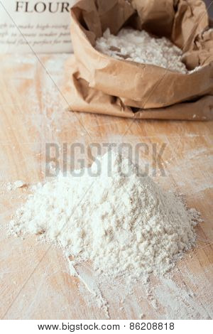 A Small Amount Of Flour On Wooden Board