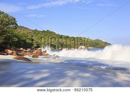 Waves at sunrise on the beach Anse Lazio