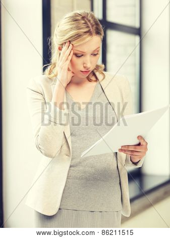 indoor picture of worried woman with documents