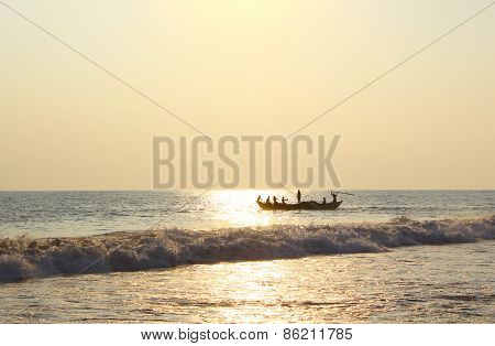 Fishermen on a boat floating in the ocean