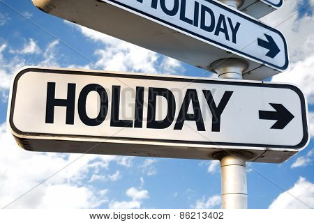 Holiday direction sign on sky background