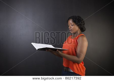 South African Or African American Woman Teacher Or Student With Diary Notepad