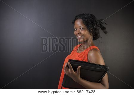 South African Or African American Woman Teacher Or Student With Notepad