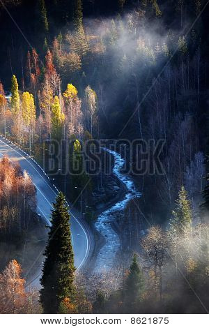 Road And River In Autumn Mountains