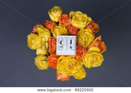 Bouquet Of Orange And Yellow Rose Flowers And Wedding Rings In Box Over Grey