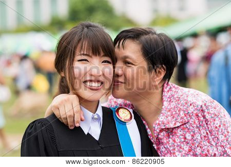 Mother Is Kissing Her Daughter With Joy For Her Master Degree Graduation