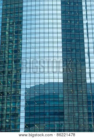 Reflection In A Skyscraper
