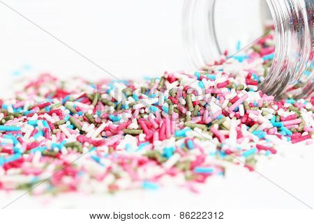 Colored sugar sprinkles and its container
