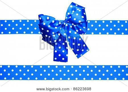 blue bow and ribbon with white polka dots made from silk isolated