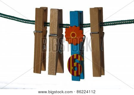 clothespins hanging on a rope