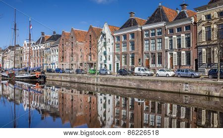 Old Ship And Warehouses Along A Canal In Groningen