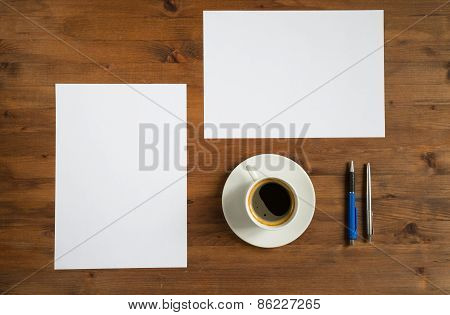 Cup Of Coffee, Two Sheets Of Paper And Two Pens